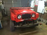 Red 1963 Nissan Patrol Front End