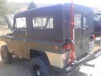 Black 1969 Nissan Patrol Rear Driver Side View
