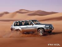 Modern Nissan Patrol in Sand